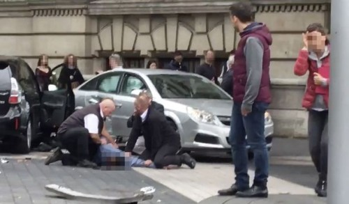 Man arrested after car hits pedestrians in London